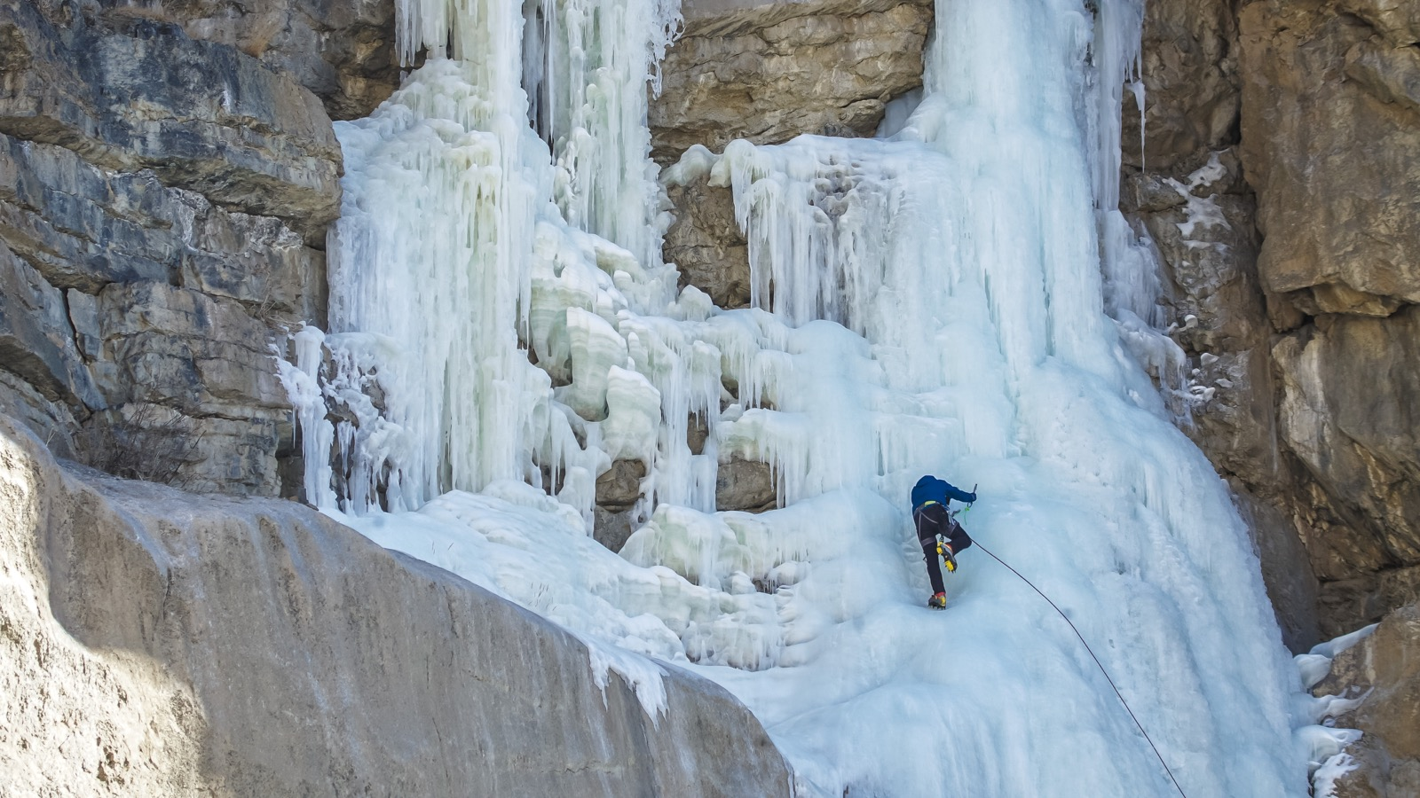 Still from The Fall. Pranav Rawat leading on the second pitch. Shela waterfall (260 ft, WI4). Near Kaza town, Spiti, Himachal Pradesh. Jan 2016. Photo © Abhijeet Singh