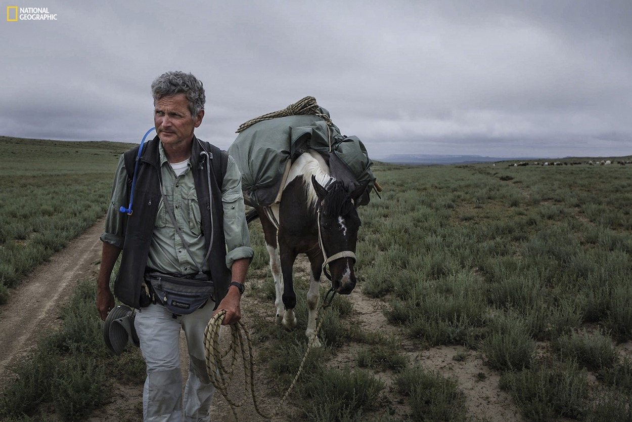 Pulitzer Prize-winning journalist and National Geographic Fellow Paul Salopek and his walking companion, Alex Moen, climbing the steppes in the Mangystau region of Kazakhstan. Join the journey at outofedenwalk.org. Photograph by John Stanmeyer / National Geographic