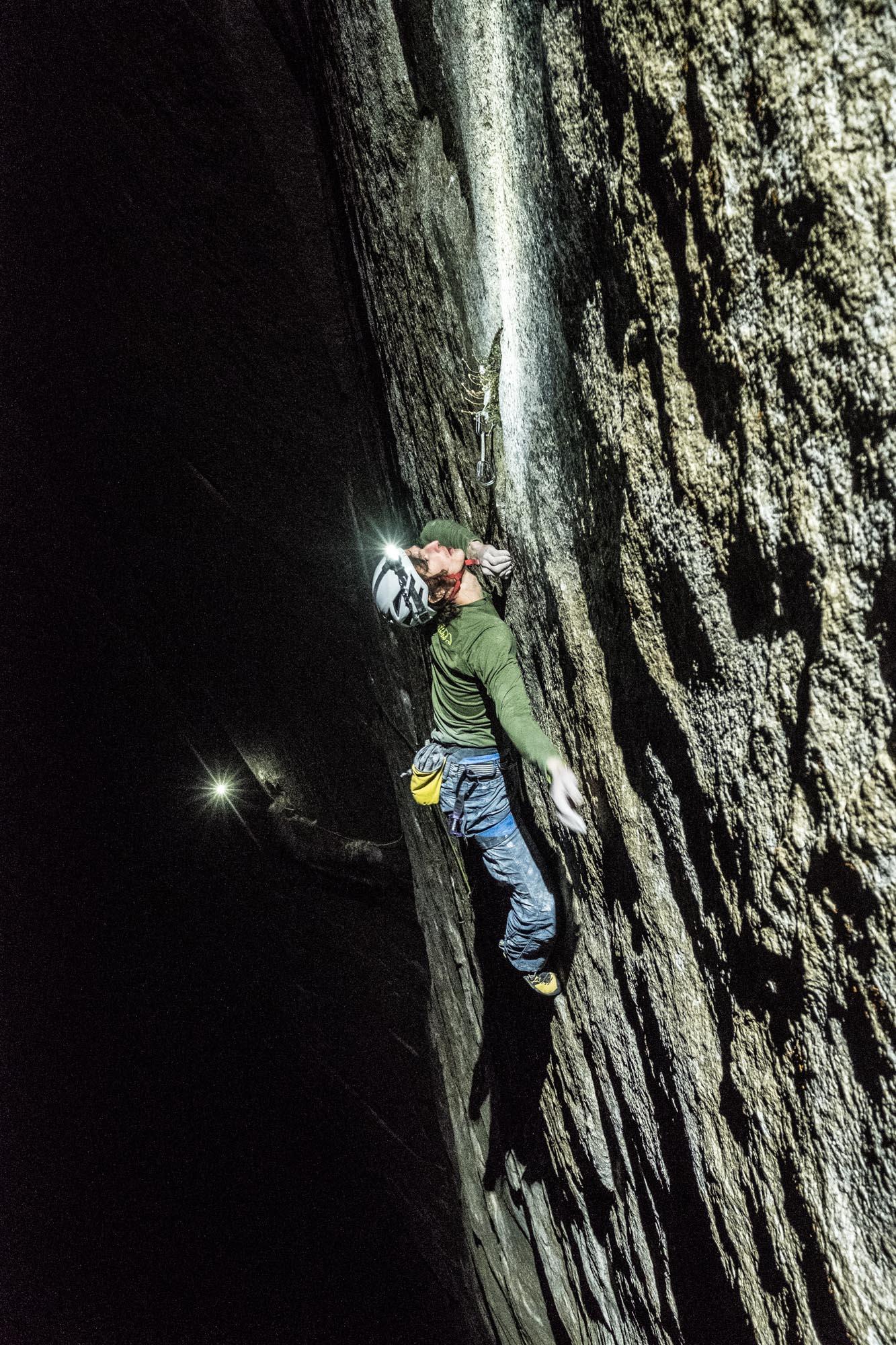 Adam Ondra climbing pitch 21 of the Dawn Wall by headlamp. Photo Courtesy Heinz Zak/ Black Diamond Equipment