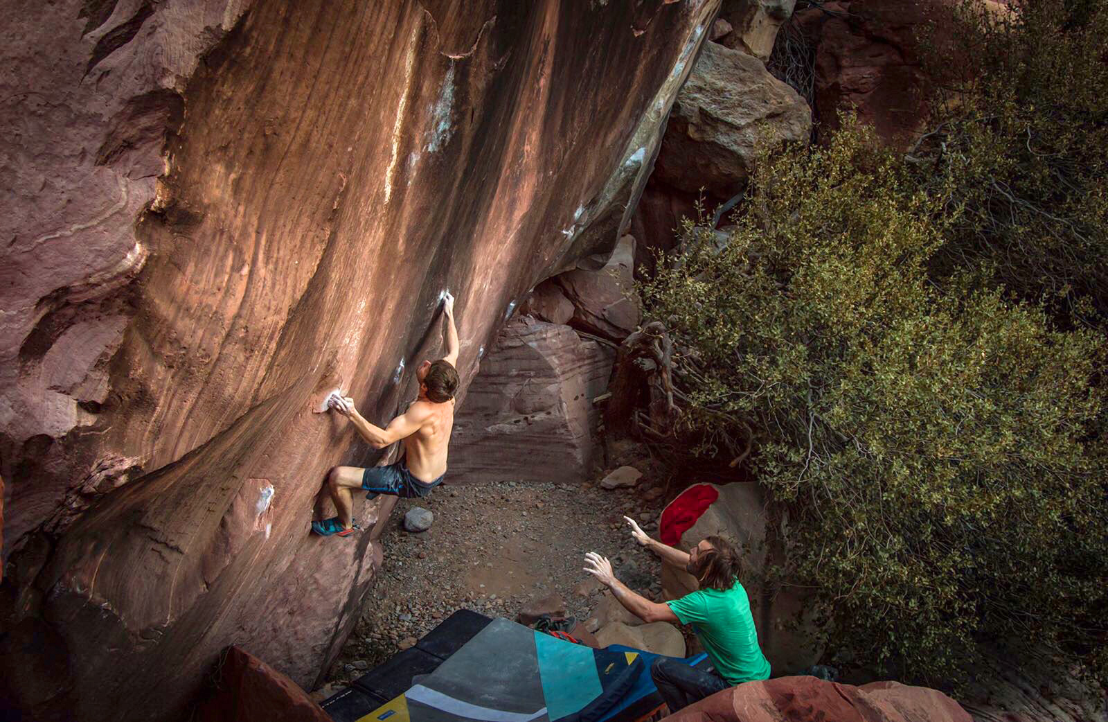 Chris Sharma spots Pol Roca on a boulder problem in Red Rocks, just outside of Las Vegas, NV. Photo: Ricardo Giancola.
