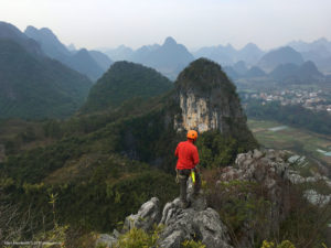 Looking out at the rolling karst landscape of Guangxi China from on top of the mountain.