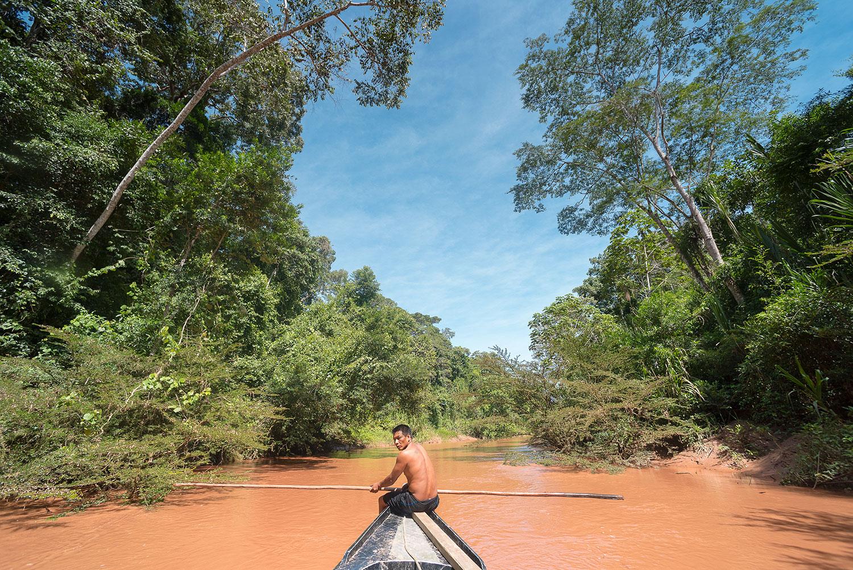 The crew's boat navigates the narrow waterway of the Yomibato River. Photo: Lina Collado