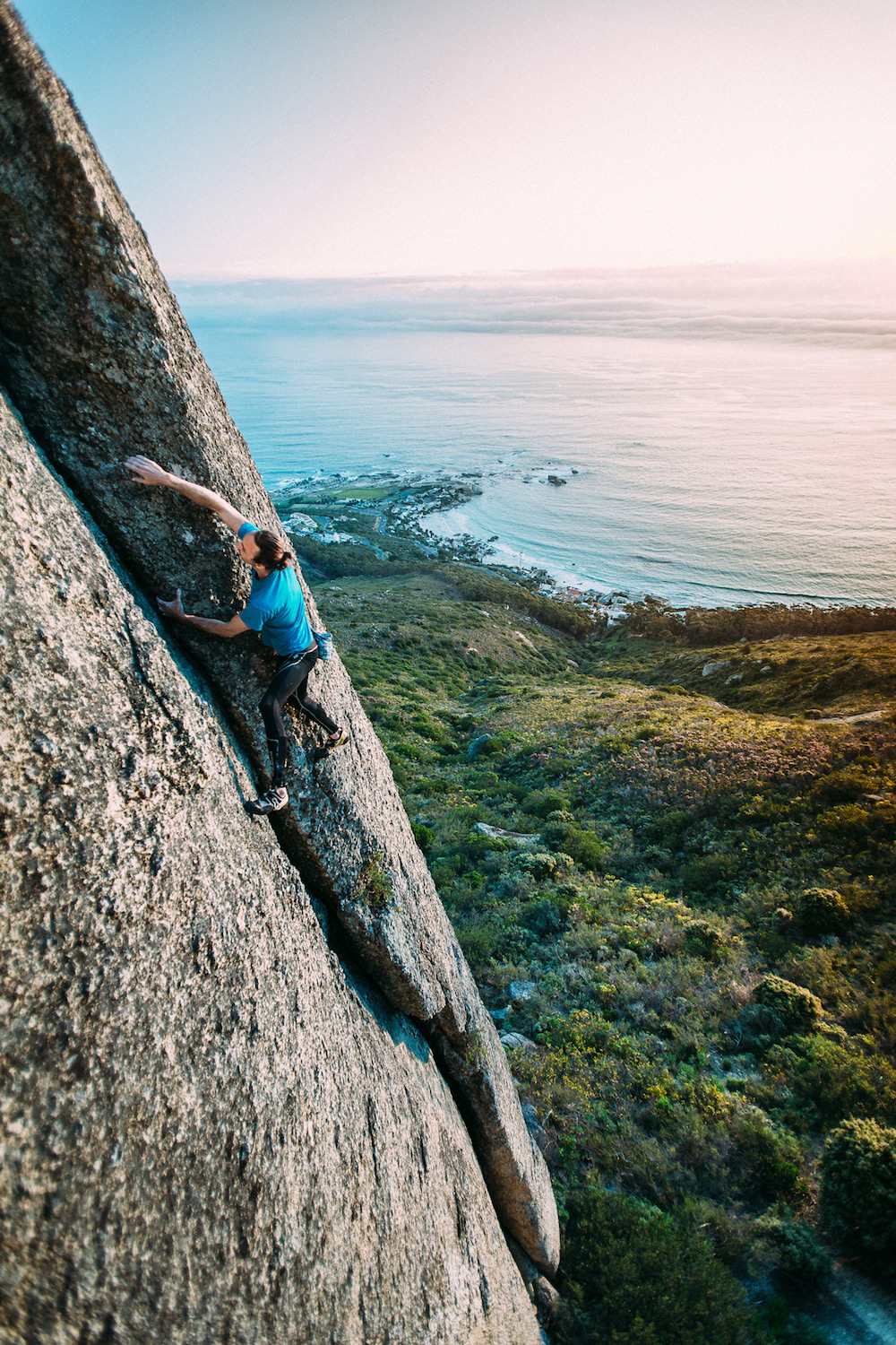 Lion Heart (5.11b/6c). Reaching the top on the first free solo ascent of Lion Heart. Lion's Head. Cape Town. Photo: Micky Wieswedel.