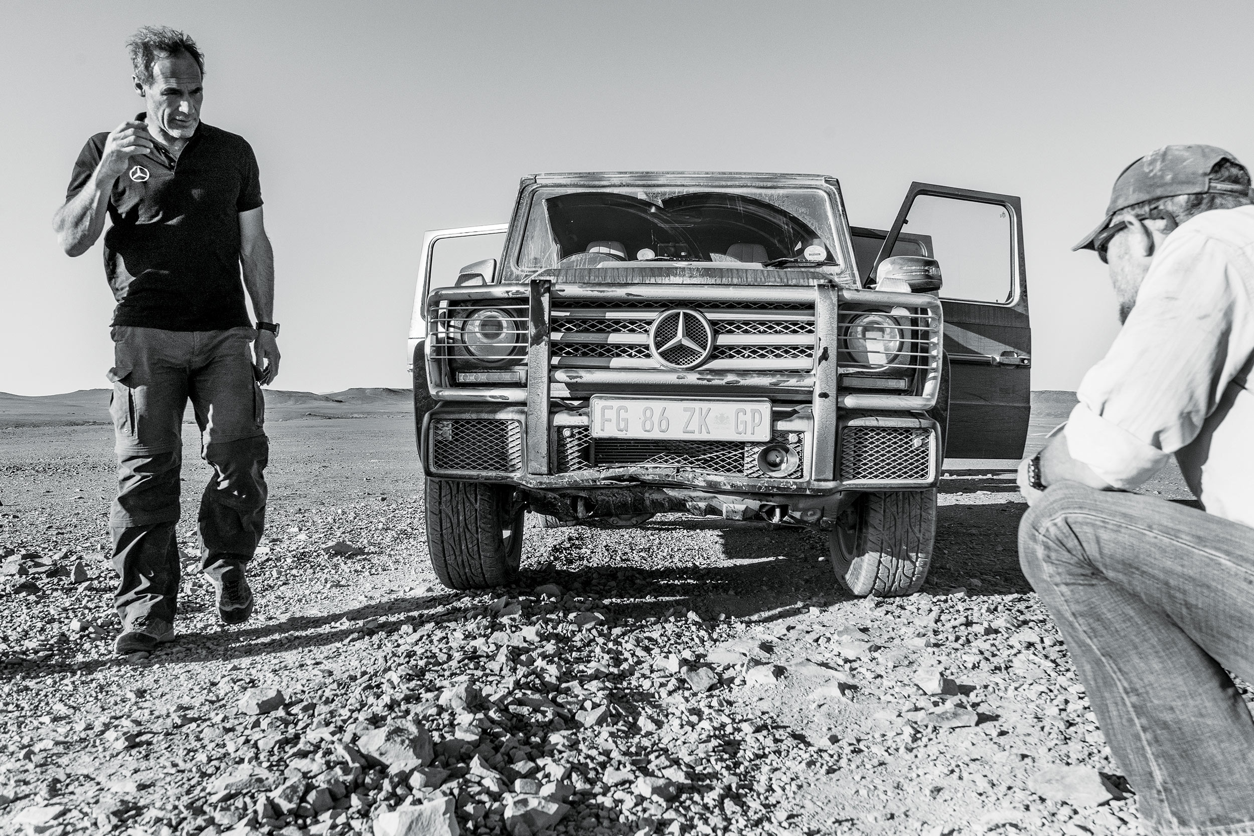 The route through the Namib desert is tough on the vehicles. One of the G-wagens hits a sudden dip in the track, denting the front bumper protecting the radiator. By this point we've already had more tire changes than we have spare tires and need to drive cautiously. Photo: Apoorva Prasad