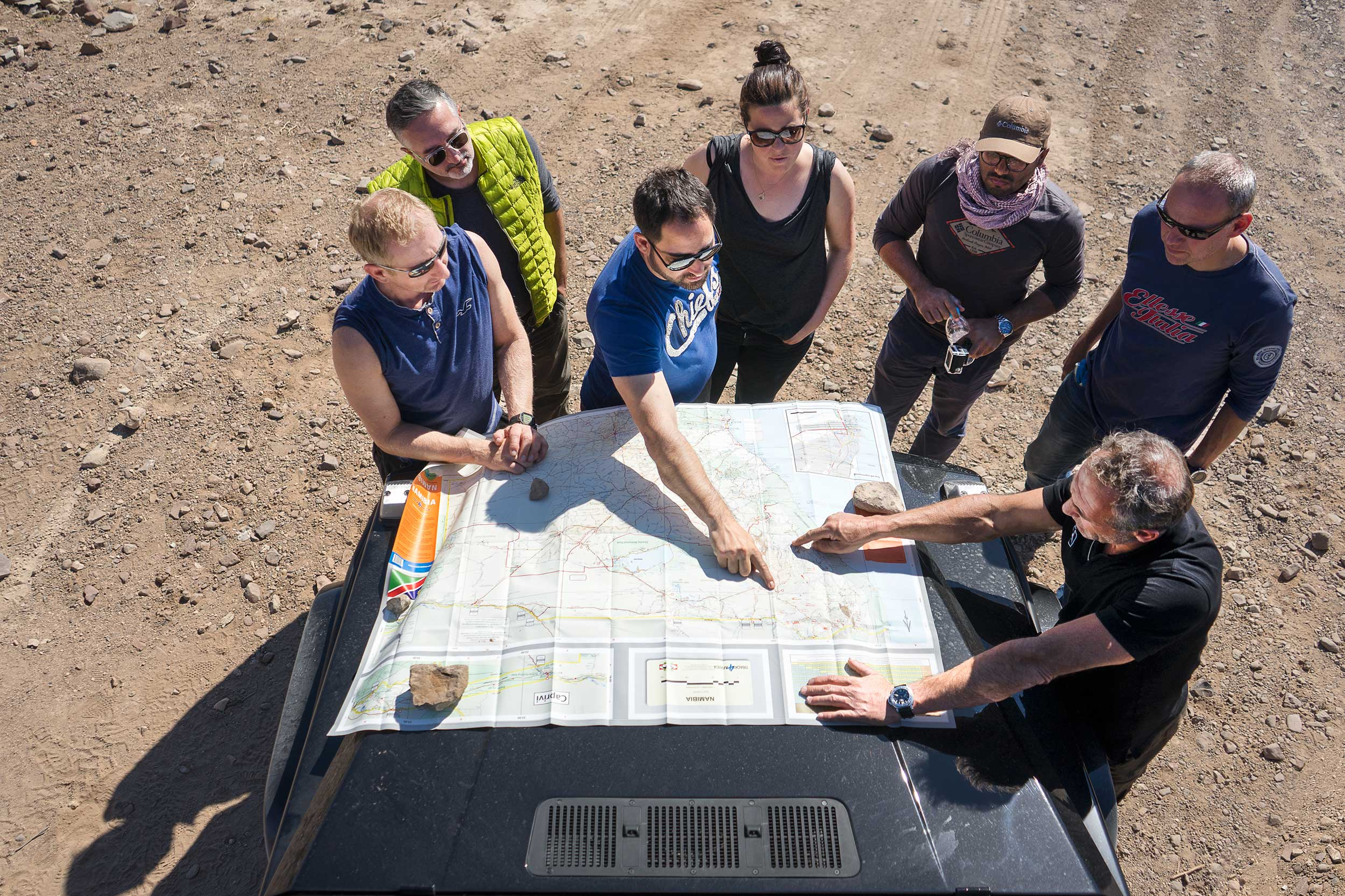 The group gathers around a map to figure out where we are today and where exactly we're headed. The drive was mostly an unplanned adventure, with Mike taking what appeared to be new and arbitrary decision about the route daily. Photo: Apoorva Prasad