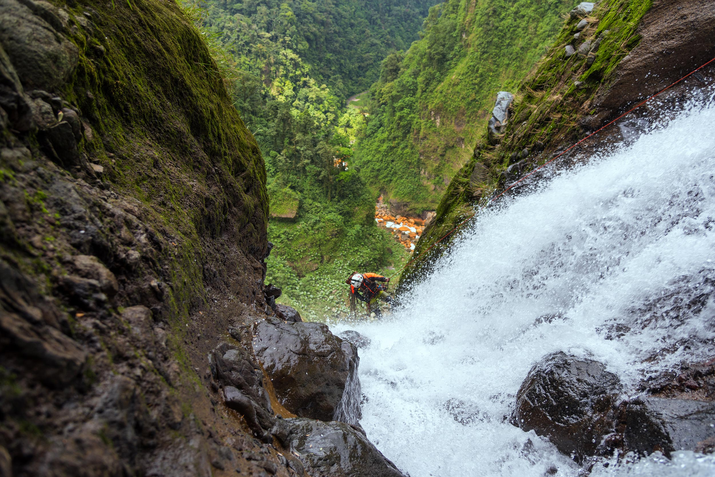 Daniel rappels off the edge of the 400 ft. monster waterfall. Photo: Victor Hugo Carvajal