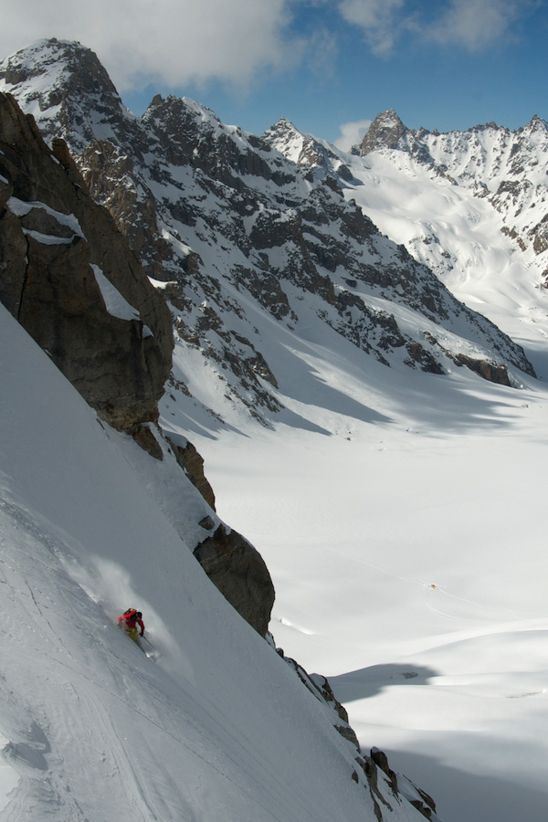 Hiaree O'Neill drops into perfect powder near 19,000 feet on an unknown flank high above the Tos Glacier.