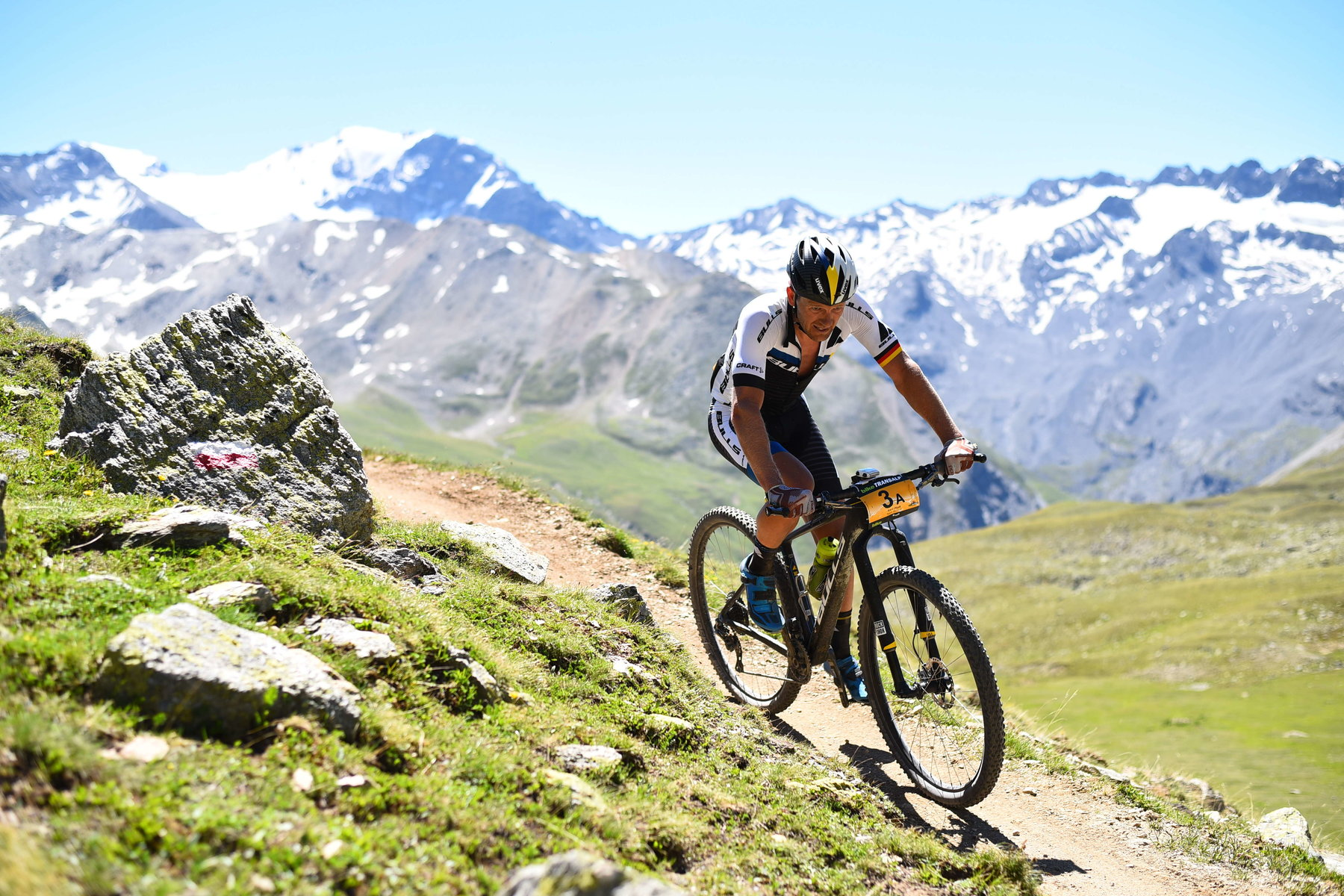 Karl racing at BIKE Transalp which he has won 7 times. Image ©: Sportograf
