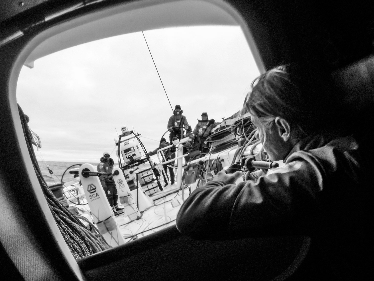 Liz Wardley looks out the hatch before her watch begins. PHOTO: CORINNA HALLORAN / TeAm SCA / VOLVO OCEAN RACE