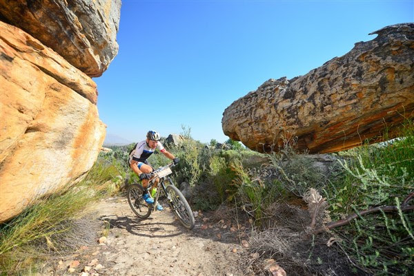 Ancient rock formations of the Kouebokkeveld region create an interesting landscape for competitors. Here, 2016 winner, Urs Huber, negotiates his way through Stage 1 singletrack. Photo credit: www.zcmc.co.za